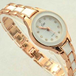 นาฬิกาข้อมือหญิง สายสแตนเลสสีทองตัดเหลี่ยมสีขาว